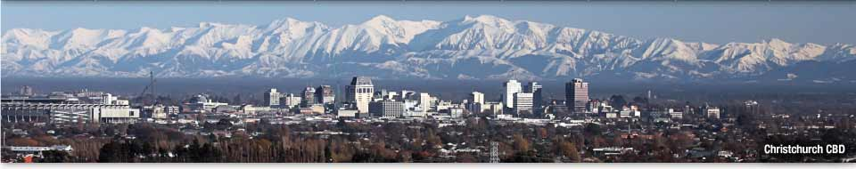 View of Christchurch CBD skyline with snow-covered mountains in the background